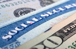 Social security card and American money